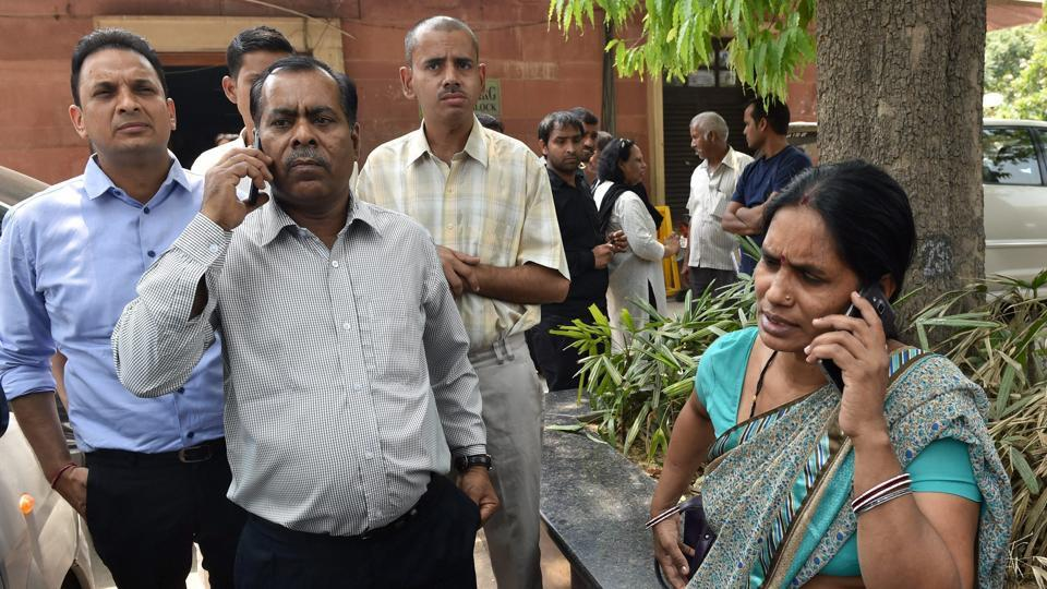 Nirbhaya's parents talk on phone at the Supreme Court in New Delhi on Friday.