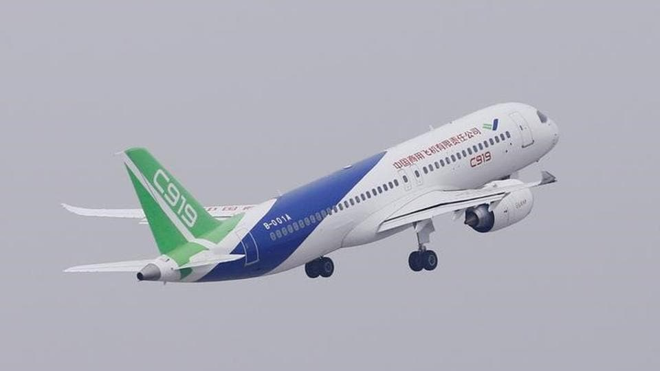 China's homemade C919 passenger jet takes off from Pudong International Airport in Shanghai.