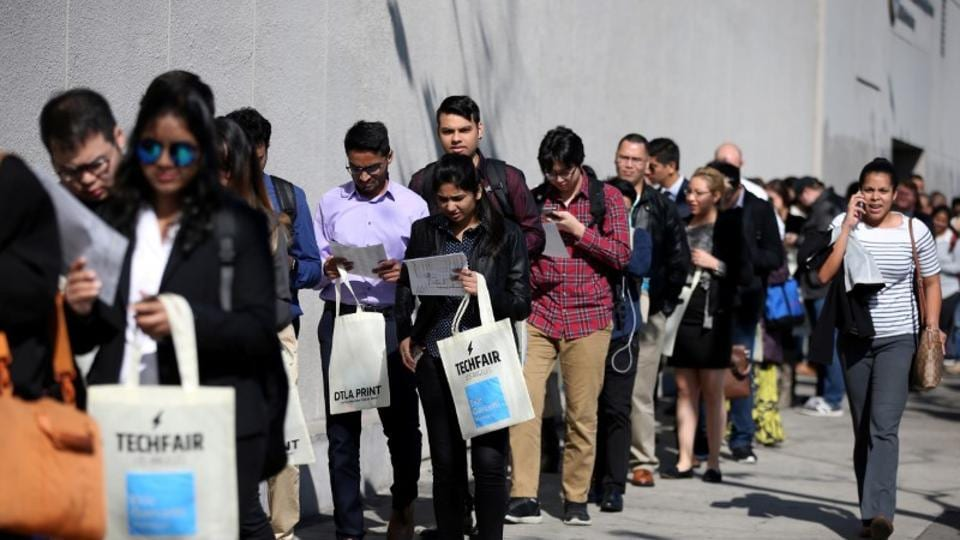 People wait in line to attend aTechFair LA, a technology job fair, in California, US.