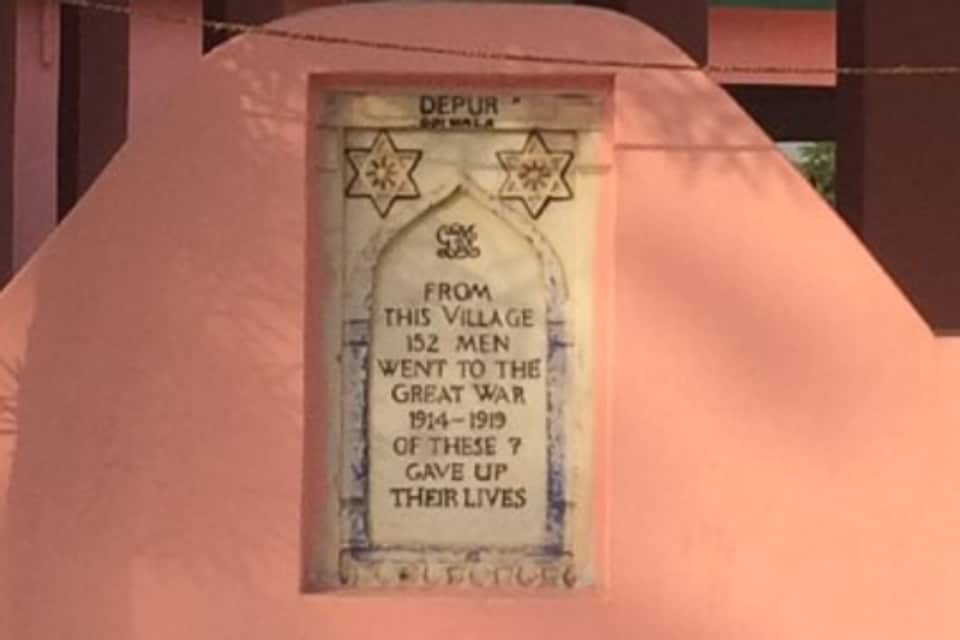 A message written on a memorial that is fixed outside the wall of a temple in Hoshiarpur's Depur village.