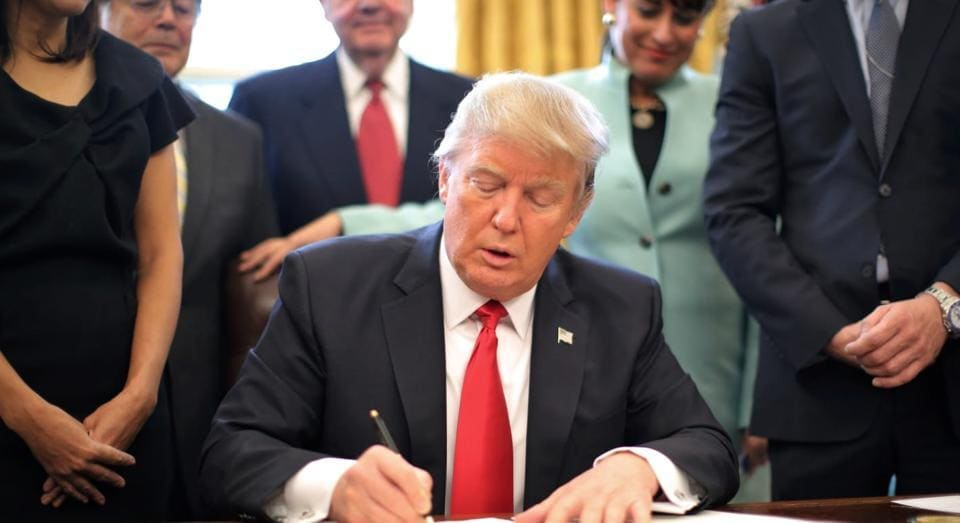 President Donald Trump signed his first piece of major legislation on Friday, a $1 trillion spending bill to keep the government operating through September.