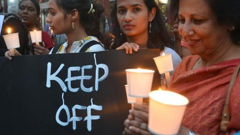 People stage a demonstration against molestation of women in Bengaluru.