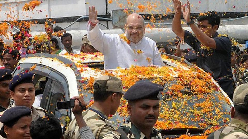 BJP national president Amit Shah waves at supporters at the Agartala airport in Tripura.