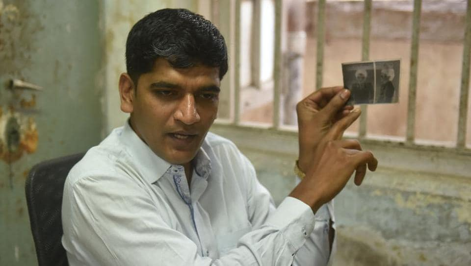 A police photographer is part of every mobile crime team in India. Sanket Rathod, a Mumbai police photographer, displaying old negatives of black and white cameras.  (Pratham Gokhale/HT Photo)