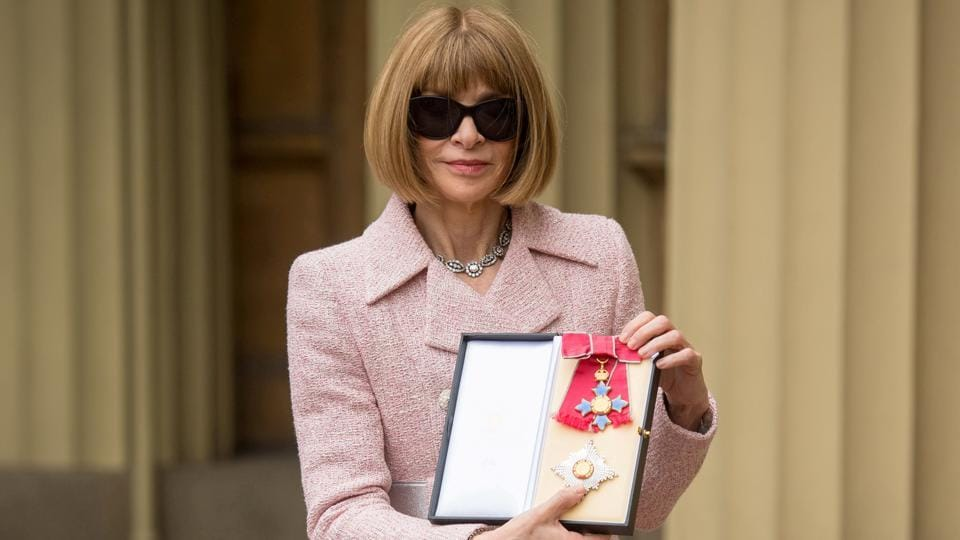 Anna Wintour, editor-in-chief of American Vogue, poses after receiving her Dame Commander from Britain's Queen Elizabeth at an Investiture ceremony at the Buckingham Palace in London.