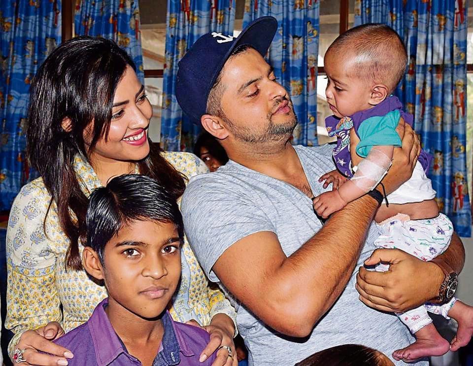 Cricketer Suresh Raina and his wife Priyanka Raina interacting with children at the Advanced Paediatric Centre, PGIMER, Chandigarh, on Saturday.