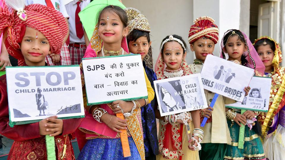 School children take part in an awareness campaign against child marriage.