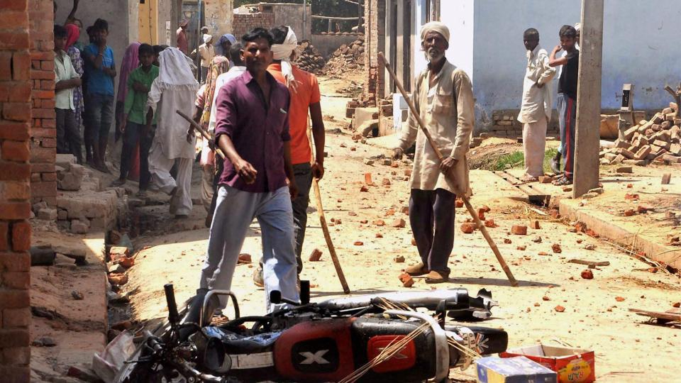 People near a damaged bike after a clash in Saharanpur on Friday.