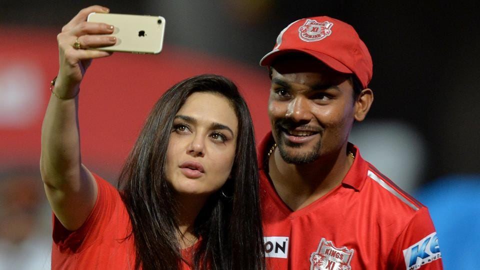 Kings XI Punjab (KXIP)owner Preity Zinta (L) enjoy a light moment with hero of the day, Sandeep Sharma, after they beat Royal Challengers Bangalore (RCB)in the Indian Premier League (IPL) on Friday. Punjab play Gujarat Lions at home on Sunday.
