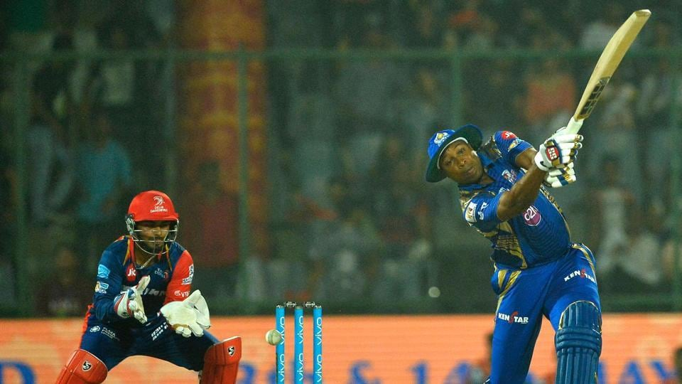 Mumbai Indians (MI) batsman Kieron Pollard (R) sends one to the ropes during the 2017 Indian Premier League (IPL) match against Delhi Daredevils (DD) at the Feroz Shah Kotla in New Delhi on Saturday.