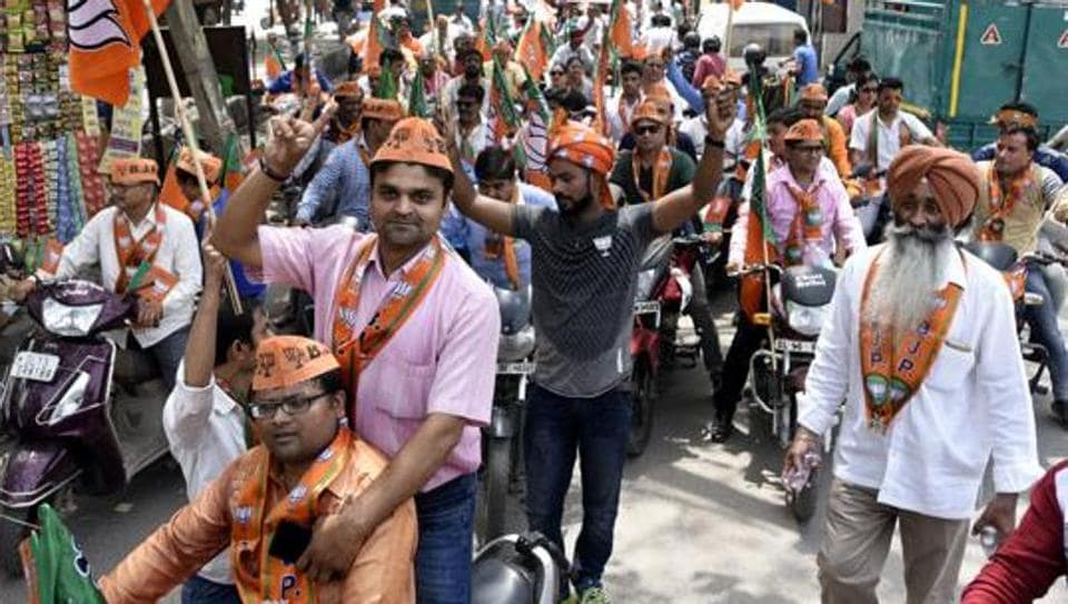 BJP workers celebrate the party's win during the Delhi municipal elections in April 2017.