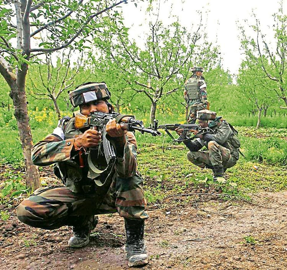 Soldiers during an operation against militants in Shopian district in Jammu and Kashmir on Friday. Thousands of army and paramilitary personnel are engaged in a huge anti-militant operation in Kashmir, where armed militants have repeatedly attacked security forces in recent weeks.
