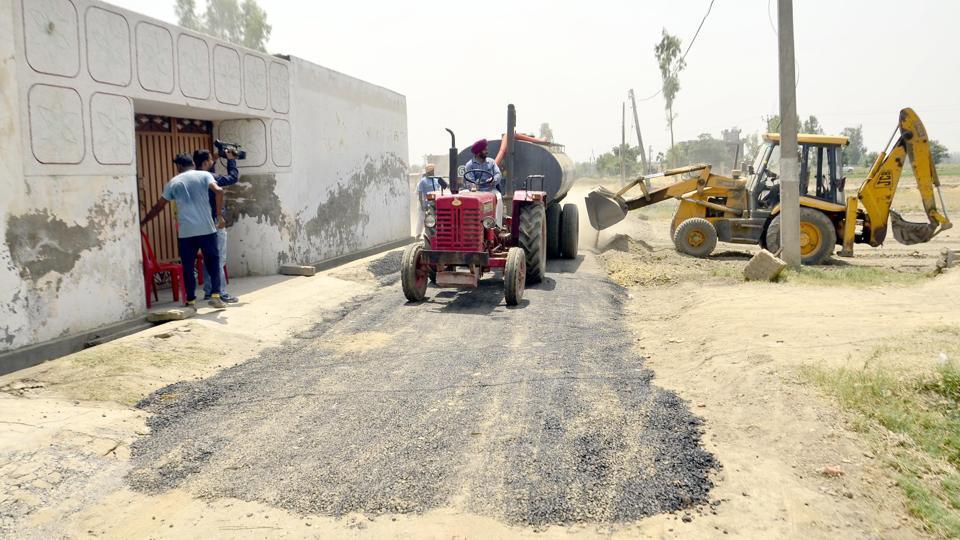 Repairs underway on a road in Vein Poin village in Tarn Taran district on Saturday, May 6.