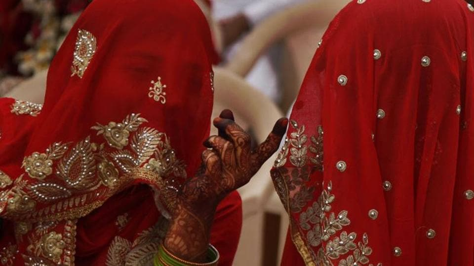 Muslim brides talk to each other before a mass wedding event in Ahmadabad, in 2016.