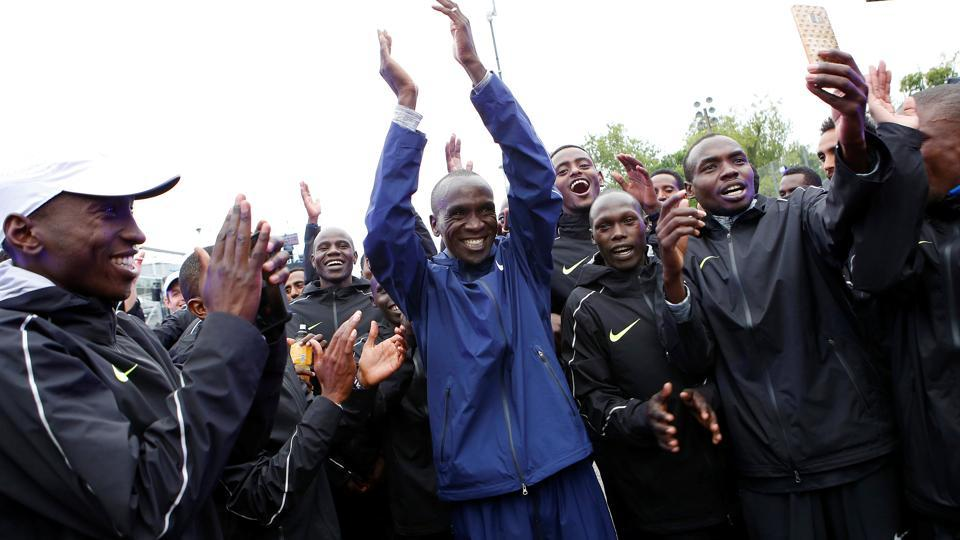 Eliud Kipchoge celebrates with pace-makers after an attempt to break the two-hour marathon barrier at the Monza circuit in Italy.