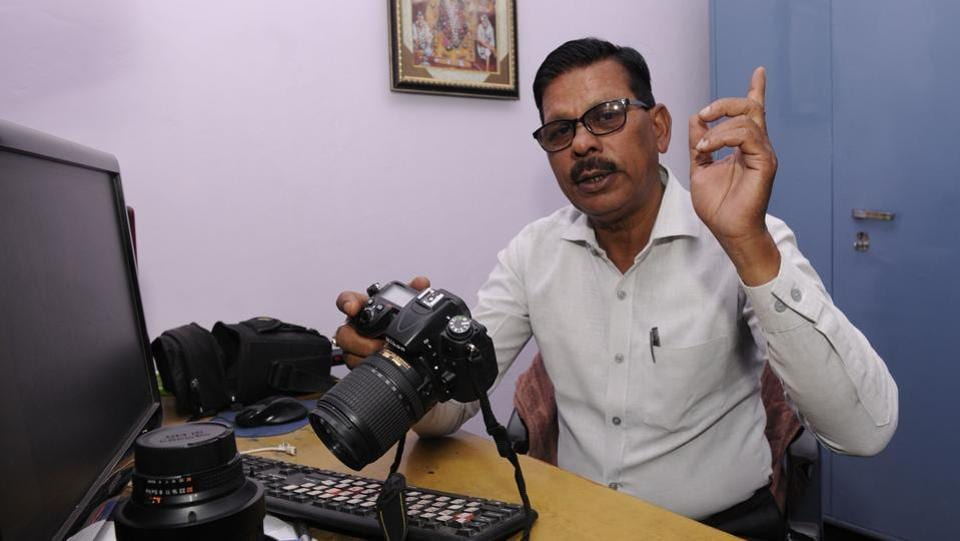 A police photographer keeps long hours. Lucknow police photographer Amitabh Singh has not taken leave for 25 years. (Ashok Dutta/HT Photo)