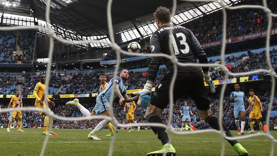 Manchester City F.C's Nicolas Otamendi scores their fifth goal against Crystal Palace during their English Premier League match on Saturday.