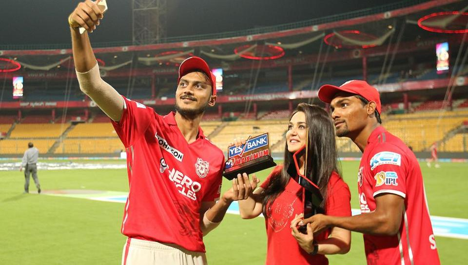 Preity Zinta takes a selfie with Axar Patel and Sandeep Sharma of Kings XI Punjab at the Chinnaswamy Stadium in Bangalore on Friday. KXIP beat Royal Challengers Bangalore by 19 runs