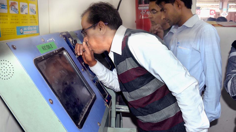 A man using a breathalyser.
