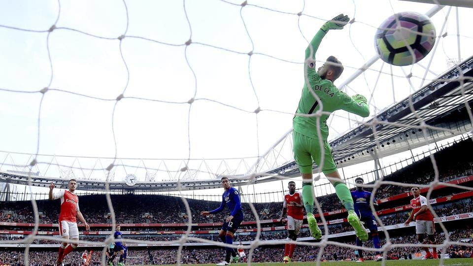 Arsenal Football Club's Danny Welbeck scores his side's second goal during the English Premier League match against Manchester United F.C. at the Emirates Stadium on Sunday.