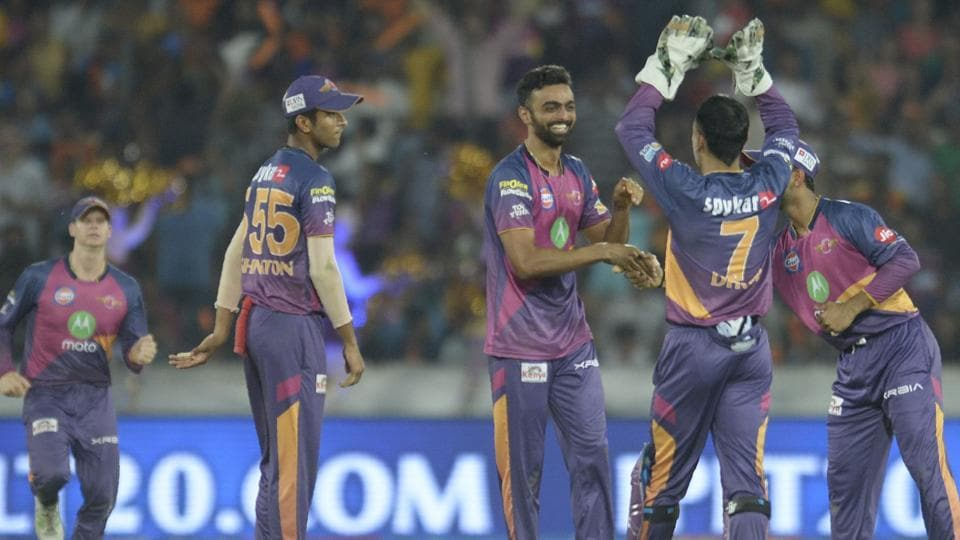 Rising Pune Supergiant's Jaydev Unadkat (C) celebrates after taking five wickets against Sunrisers Hyderabad during their 2017 Indian Premier League (IPL) T20 match at the Rajiv Gandhi International Cricket Stadium in Hyderabad on Saturday.