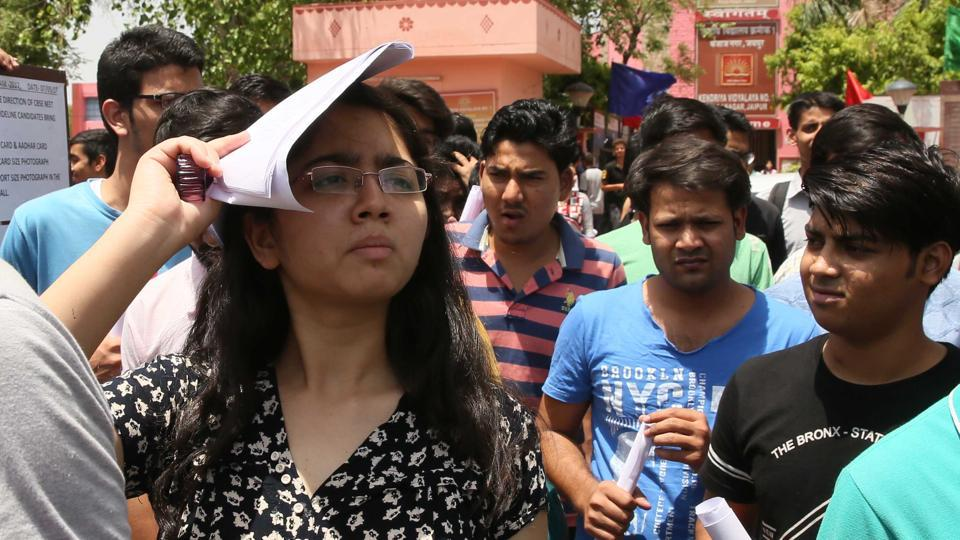 Students come out after appearing for NEET in Jaipur on Sunday.