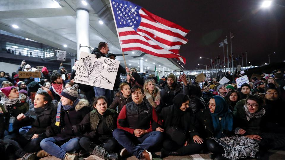 People gather to protest against the travel ban imposed by U.S. President Donald Trump's executive order, at O'Hare airport in Chicago, Illinois, U.S. January 28, 2017.
