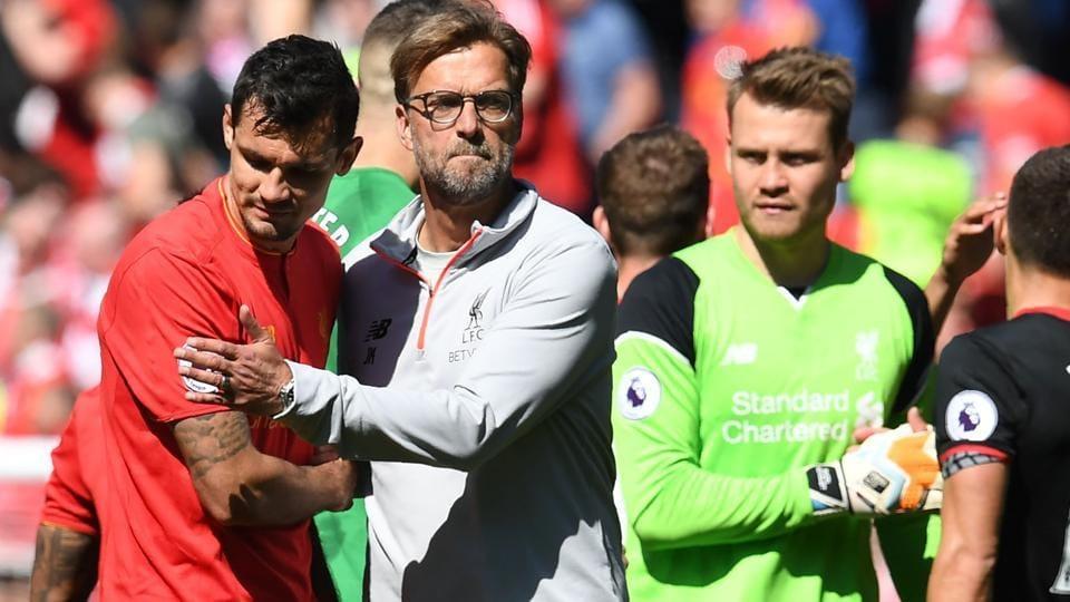 Liverpool manager Jurgen Klopp (C) embracesdefender Dejan Lovren after the Premier League match between Liverpool and Southampton.