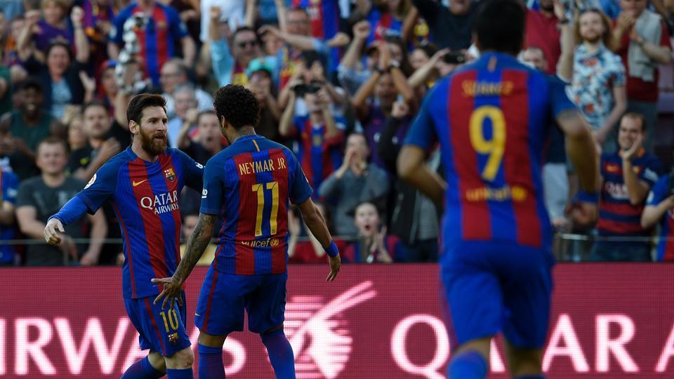 FC Barcelona forward Lionel Messi (left) celebrates with teammate Neymar (centre)after scoring during the Spanish La Liga match vs Villarreal CF at the Camp Nou stadium in Barcelona on Saturday.