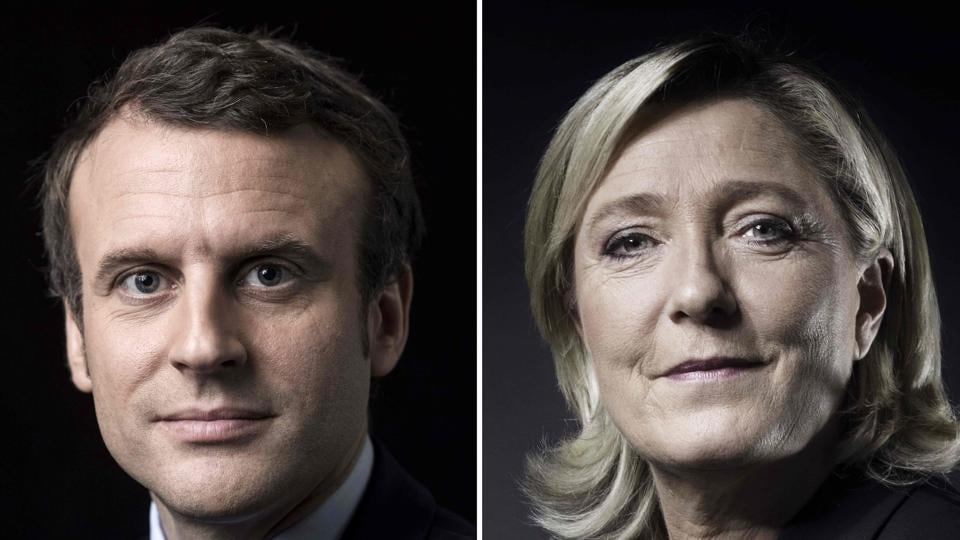 This combination of pictures made on April 23, 2017 shows French presidential election candidate  Emmanuel Macron (L) and French presidential election candidate for the far-right Front National (FN) party Marine Le Pen posing in Paris.