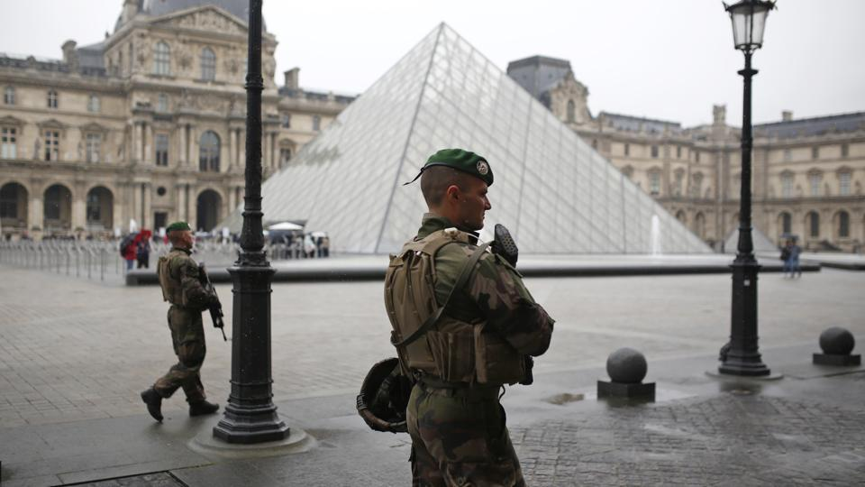 Soldiers patrol in the courtyard of the Louvre museum in Paris on May 7.