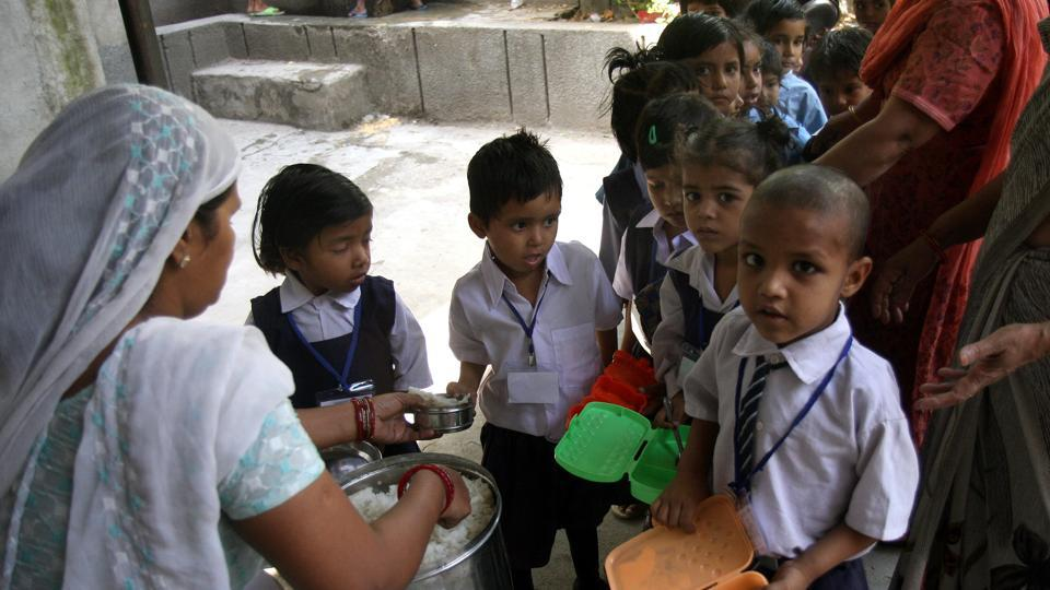 Students at a MCD School waiting for mid-day meal in Patpargunj in New Delhi on Friday.