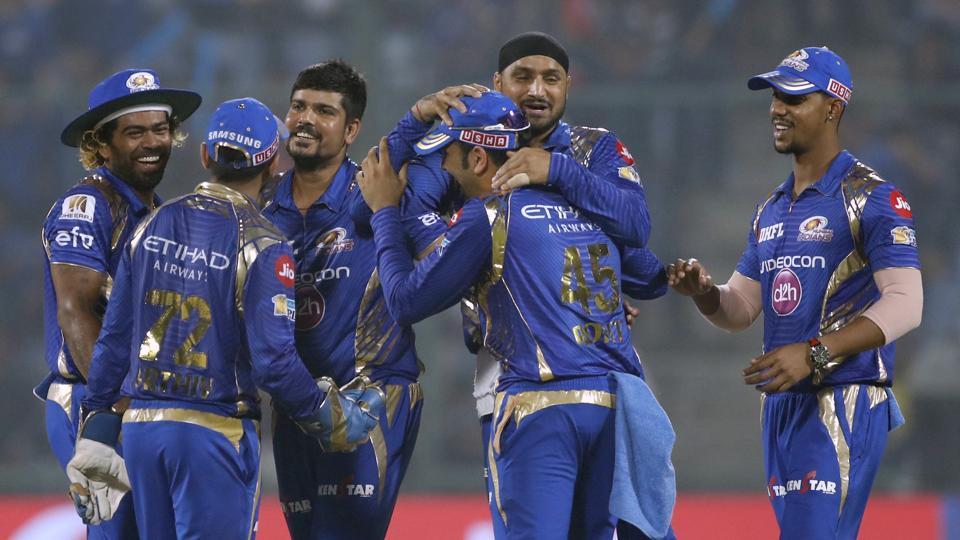Mumbai Indians' team celebrate the dismissal of Delhi Daredevils' Marlon Samuels during their Indian Premier League (IPL) match in New Delhi on Saturday.
