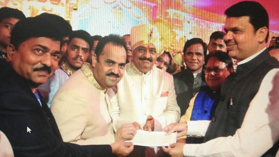 BJPMPSanjay Kakade (second from left) hands over a cheque of Rs1crore as a donation for disadvantaged kids to CM Devendra Fadnavis at Shree Chhatrapati Shivaji Sports Complex in Pune on Sunday.