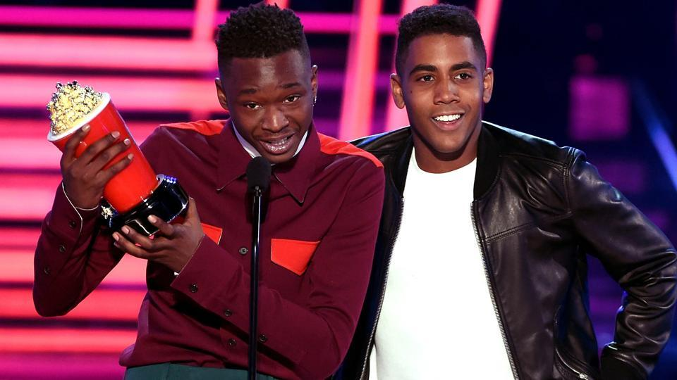 Actors Ashton Sanders (left) and Jharrel Jerome accept the Best Kiss award for Moonlight at the glittering awards ceremony.  (AFP)