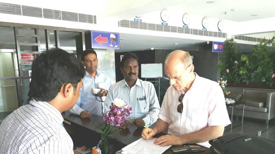 A French consulate official collects details of voters in Yanam.