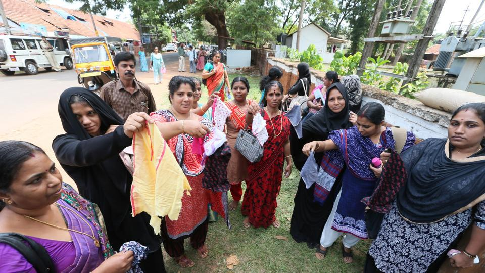 Testing time: Agitated parents show cut out portions of their children's dress outside a school in Kannur, Kerala. A girl was forced to remove her inner wear after the metal detector beeped before entering the hall for NEET exam triggering protest in the state.