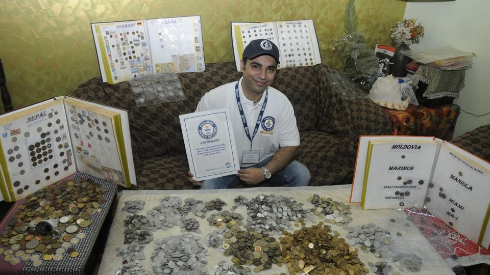 Manish Dhameja with his collection of coins.