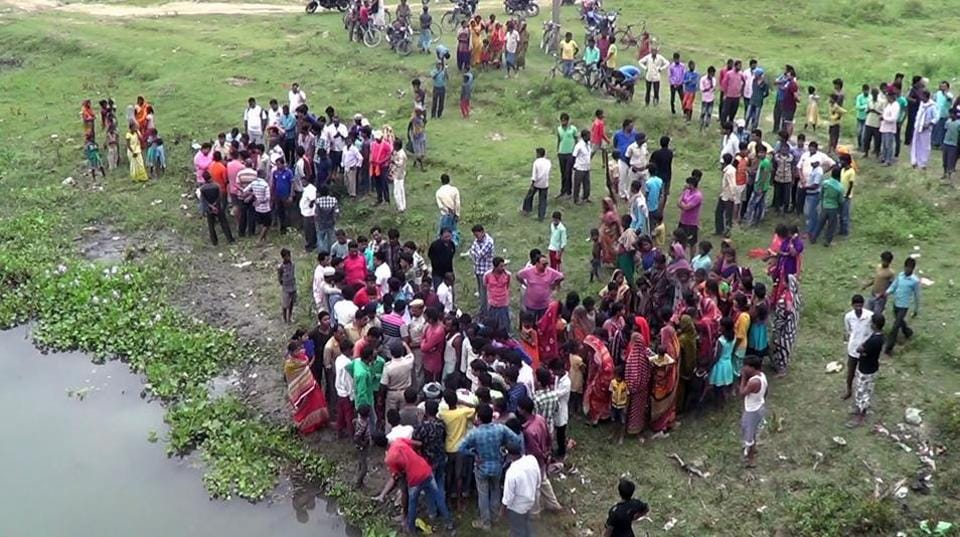 An anxious crowd near the river from where the body of the victim was recovered.