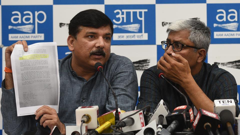 AAP leaders Sanjay Singh, Ashutosh and Dilip Pandey during the press conference in New Delhi  where they accused the BJPof conspiring to crush their party.