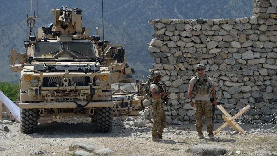 US soldiers patrol near the site of a US bombing during an operation against Islamic State (IS) militants in the Achin district of Afghanistan's Nangarhar province on April 15, 2017.  A raid by USand Afghan troops in the Nangarhar region killed the leader of ISIS-Khorasan, Abdul Hasib.