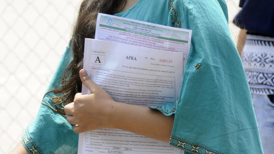 Student coming out after appearing in the NEET examination at a centre in Noida on Sunday.