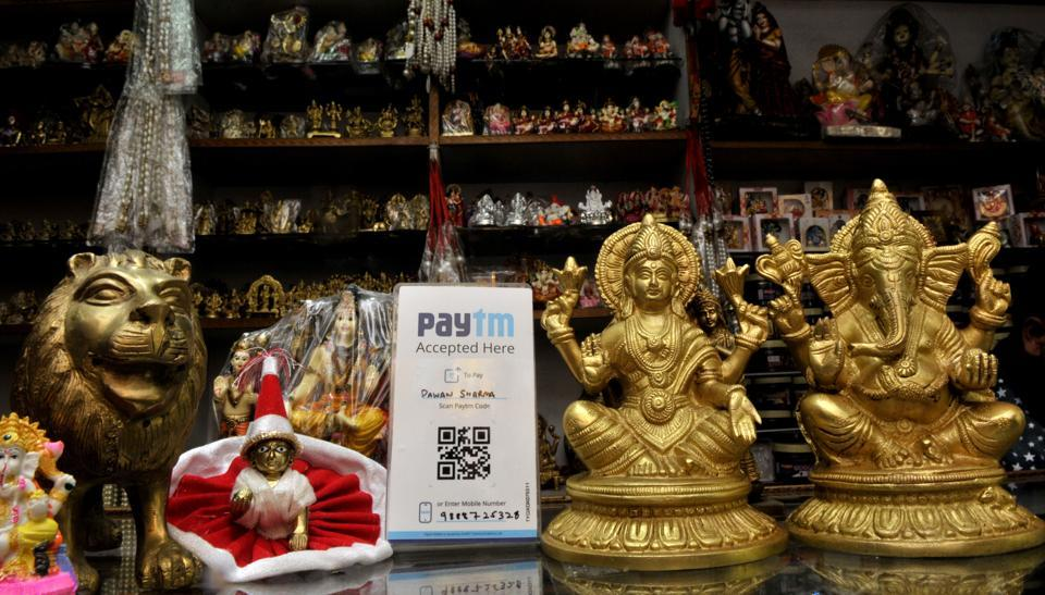A Paytm barcode in a idol shop near the temple in sector 20 Chandigarh.