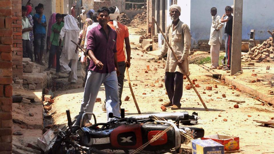 People near a damaged bike after a clash during a Shobhayatra in Saharanpur on Friday.