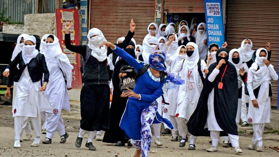 Students pelt stones at security personnel during clashes at Lal Chowk in Srinagar  against alleged rights violation by forces in Kashmir.