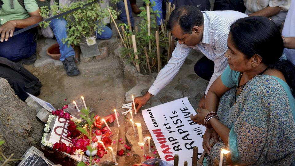 Parents of the December 16, 2012, gang rape victim Asha Devi and BN Singh light candles at a memorial at Jantar Mantar, New Delhi, May 5, 2017