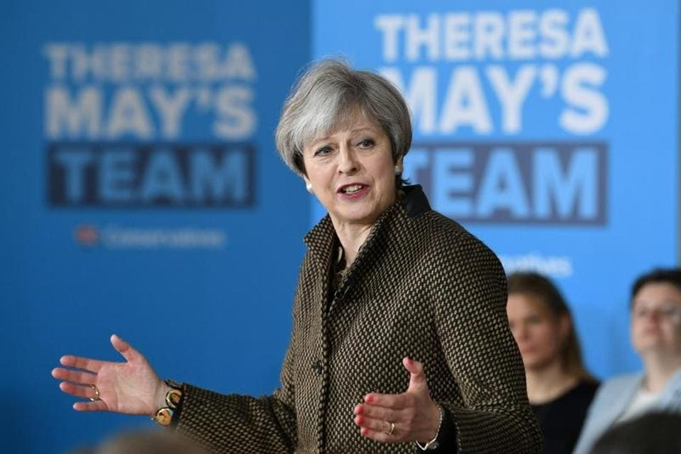 Britain's Prime Minister Theresa May addresses Conservative parliamentary candidates for London and the south east at the Dhamecha Lohana Centre in Harrow, north west London on May 8.