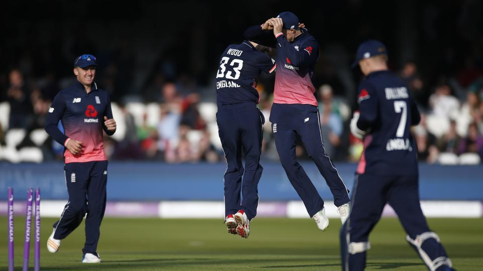 England cricket team's Mark Wood and Joe Root celebrate after taking the wicket of Ireland cricket team's George Dockrell during the 2nd ODI at Lord's onSunday.