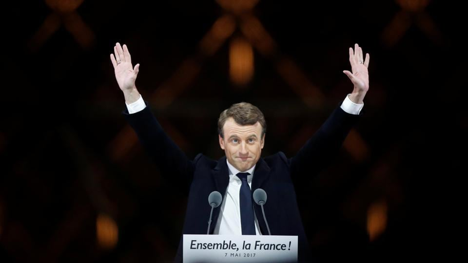 French President-elect Emmanuel Macron celebrates on the stage at his victory rally near the Louvre, Paris, France, May 7
