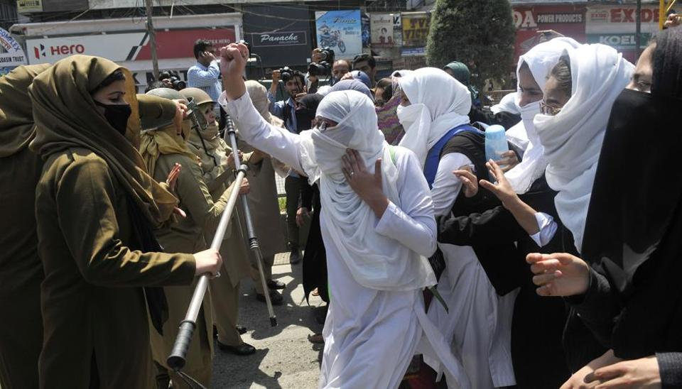 Kashmiri students shout slogans during a protest at Lal Chowk, Srinagar on April 17, 2017. Violence erupted in Srinagar as students staged a protest after more than 60 students were injured in clashes with security forces at a college in the district of Pulwama.